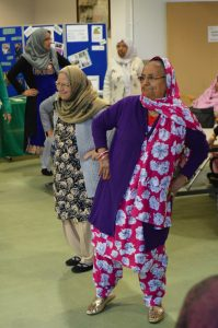 Two ladies dancing at Dhek Bhal workshop